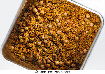 Ras el hanout spice mixture in a metal can seen from above