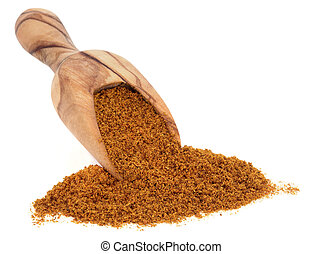 Ras el hanout moroccan spice in an olive wood scoop over white background.