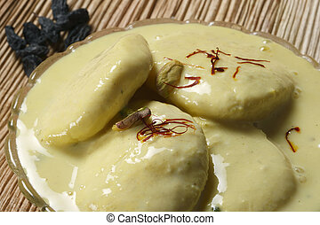 Ras Malai is a sweet dish invented in Bengal and found in India. Ras malai consists of sugary, cream to yellow-colored balls (or flattened balls) of paneer soaked in malai (clotted cream).