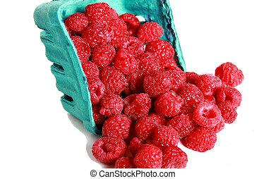 Rasberry - Close up of big red raspberries in a quart.