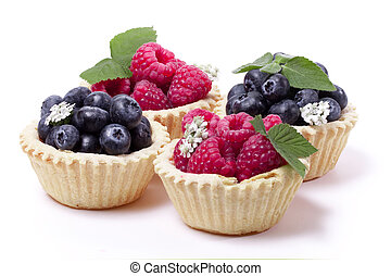 Raspberries and blueberry and blueberries in a waffle basket