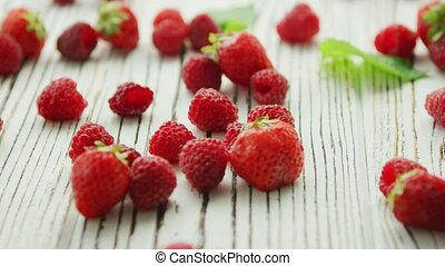 Raspberries and strawberries on table - Bunch of fresh...