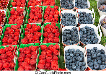raspberries, blueberries in the market
