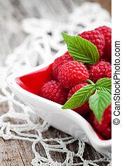 Raspberries - Bunch of fresh raspberries in white bowl