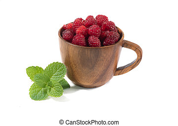 Raspberries in a wooden cup on a white background.