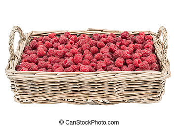 Raspberries in the basket isolated on white background