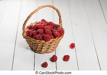 raspberries in the basket on white background