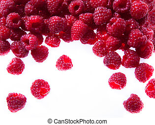 raspberries on white background - sweet red raspberries pour...
