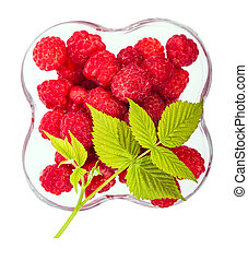 raspberries view from the top and a green leaf