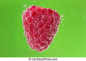 raspberries with bubbles in water