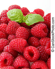 raspberries with leaves on white background