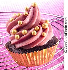 cupcake in a golden case