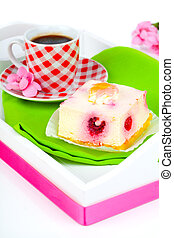 raspberry cake with coffee cup, in a tray for breakfast.