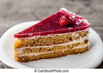 Raspberry cake with white chocolate on a plate. Delicious dessert