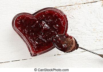 Raspberry jam in heart shaped glass dish