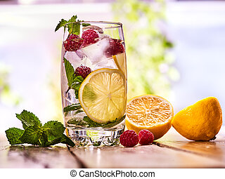 Raspberry mojito with cubes ice glass. Outdoor. - Alcohol...