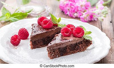 raspberry mousse chocolate dessert on wooden underground