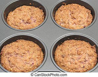Raspberry muffins in a muffin cake pan