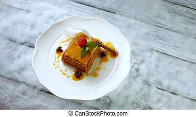 Raspberry on a cake. Cake with cinnamon stick. Plate with...