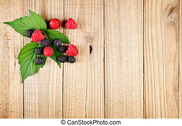 Raspberry on wooden background