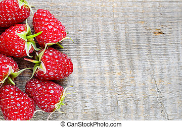 Raspberry on wooden background