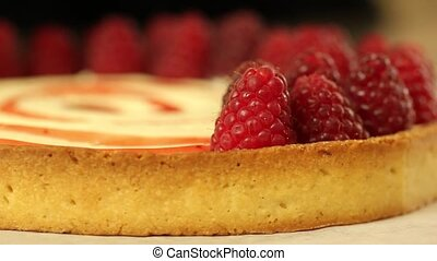 raspberry tart decorating - tart is being decorated with...