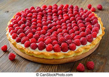 Raspberry tart on wooden table
