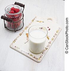 raspberry vintage ware on a wooden board