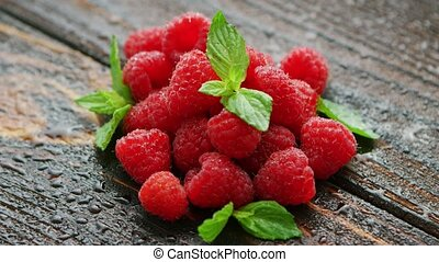 Raspberry with green leaves - Closeup heap of raspberry and...