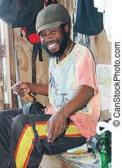 rasta craftsman smiling with threading tool