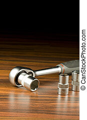 ratchet - Ratchet spanner and sockets on wood background