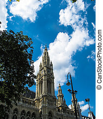 rathaus in wien and dramatic sky in the background