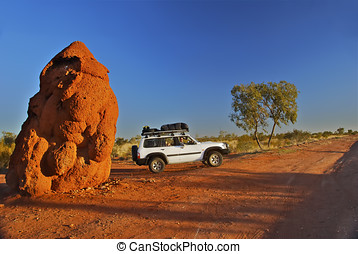 rather large anthill - an anthill dwarfs a large 4x4 vehicle...