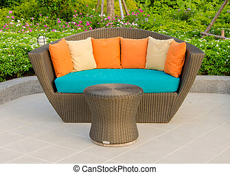 Rattan armchair furniture in garden.