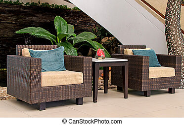 Rattan armchair furniture. Interior of a living room.