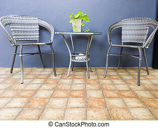 Rattan armchair with the small table set in the vintage style.
