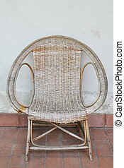 rattan chair on white wall