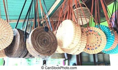 Rattan eco bags in the art shop on Bali island, Indonesia....