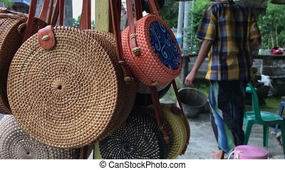 Rattan eco bags in the art shop on Bali island, Indonesia....