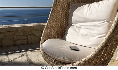 Rattan Furniture at the Sea View. Gadget at the Chair. -...