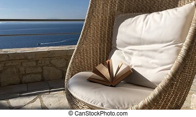 Rattan Swing Chair With Seaview in a Sunny Day - Hanging Egg...