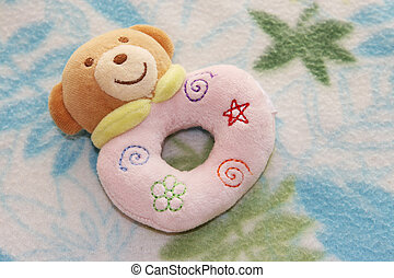 Rattle - Baby's toy rattle on a baby blanket.