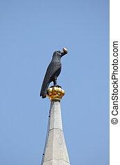 Raven holding a golden ring