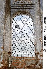 Raven in a church window