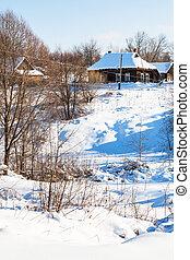 ravine and little russian village in winter