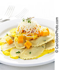 Gourmet squash ravioli dinner served with cheese on plate