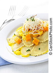 Ravioli dinner - Gourmet squash ravioli dinner served with ...