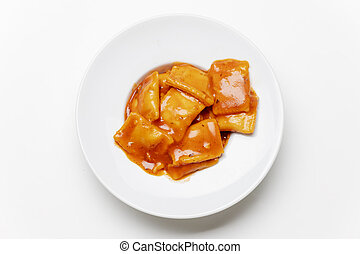 ravioli in a plate on white background
