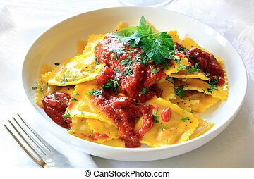 Ravioli with bolognese sauce, garnished with parsley.