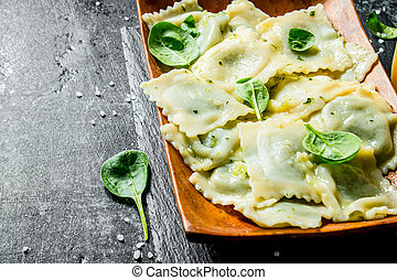 Ravioli with greens on a plate.